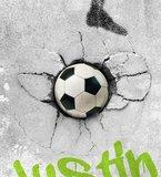 Voetbal in muur detail